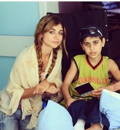 """Bathoul meeting 11 year old Khaled.  """"I will never forget when I asked 11 year old Khaled as he sat in his hospital bed with 46% burns to his body what he wanted to do when he gets older. He looked away and then down at his blood stained bandaged legs. Silence. He then said 'I don't think about that any more'."""" Photo by B. Ahmed/2014."""
