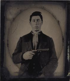 ca. 1860-70's, [tintype portrait of a tough-looking gentleman with his Colt 1849 pocket revolver] via Heritage Auctions