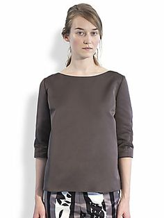 """Marni Pleated Duchess Satin Top $840 Luxe duchess satin, shaped with a crisply rendered inverted back pleat.  Modified boatneck Three-quarter sleeves Inverted back pleat About 24"""" from shoulder to hem Polyester Dry clean Made in Italy"""