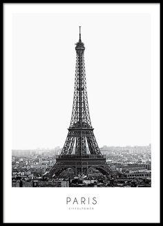 Stilvolles Poster mit Fotografie des Eiffelturms in Paris. Tolles und modernes Plakat mit Fotokunst, das wunderschön in einen schwarzen Rahmen passt. Dieses Poster lässt sich leicht mit anderen Postern, zum Beispiel solchen mit Fashion-Motiven oder Typografie, kombinieren. www.desenio.de