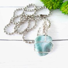 Kyanite Crystal Pendant or Amulet Wire Wrapped smooth crystal on adjustable cord