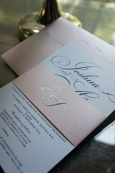Silver foil stamping wedding logo with pastel pink paper band wedding invitation