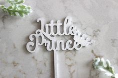 Top off your celebratory cake with our stunning and sweet Little Prince cake topper! Here, at The Confetti Home, we take great pride and joy in our creations, knowing that every detail is important to your special occasion, and handpicked by you! We create our toppers with excellence and high-quality materials to present you with a cake topper you are sure to love.  // KEEPSAKE CHARM //  We know that memory making is important, which is why we carefully package our wood an...