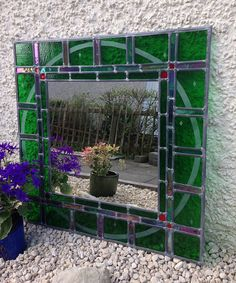 Large decorative green glass mirror with sandblasted surround. Made-to-order!
