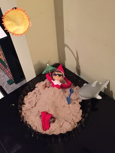 Elf on the shelf chilling on the beach