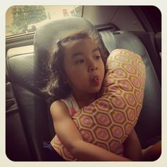 Seatbelt pillows. great idea for long travel