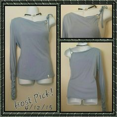 ☆HP!☆ NWT- Sky blue long sleeve one shoulder top Extremely unique long sleeved single shoulder top in sky blue from Fred Segal.  Top has ring tie on left shoulder.  Versatile and flattering for all body types.  Goes great with almost anything.  From jeans to a skirt,  this top is versatile and sexy! Always stay in style with this rare one-shoulder shirt from Santa Monica's Fred Segal! akdmks Fred Segal Tops
