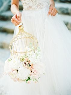 Floral wedding decoration with gold bird cages