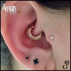 Daith piercing by Johnny Pearce of Affinity Tattoo. Jewelry by BVLA.