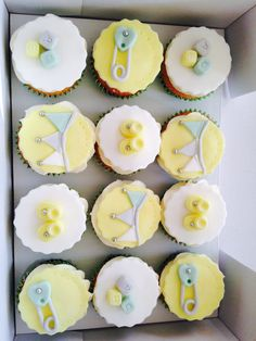 These are some baby shower cupcakes that I've made, we don't know the sex of the baby yet so I've played it safe using White,Yellow, Green & Grey pastel colours & a little bit of silver lustre!