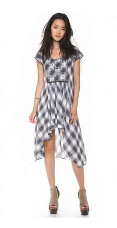 RAD FOR PLAID DRESS $56.32 Embroidery and crochet trim lend bohemian charm to a plaid Free People dress. The uneven skirt is detailed with tiered layers, and a half-moon cutout accents the back. Short sleeves. Lined.