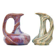 EDMOND LACHENAL (1855 - 1930) ATELIER DE GLATIGNY Swirling stoneware and porcelain pitchers, oxblood and ivory glazes, France, ca. 1899-1900 Signed LACHENAL, stamped Glatigny mark
