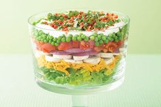 With tomatoes, peas and red onions, this gorgeous layered salad looks and tastes like summer-in-a-bowl.