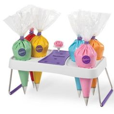 Keep your frosting bags close at hand--and your frosting flowers neatly organized on the built-in nail grips--with this cake decorating bag holder. From Wilton. Cake Decorating Icing, Creative Cake Decorating, Cake Decorating Supplies, Cake Decorating Techniques, Baking Supplies, Creative Cakes, Cookie Decorating, Decorating Tips, Cake Supplies