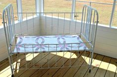 A Vintage Baby Bed Turned Into A Comfy Bench
