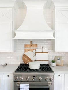 Bright white vent hood in our kitchen with white subway tile!