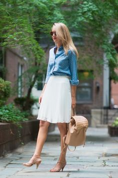 This look is super accessible because almost every woman of the workforce has a few skirts and blouses. A chambray top is casual but can be dressed up with a feminine and flowy skirt. This backpack that The Classy Cubicle wears is edgy and toughens up her look. Plus, it can fit you computer inside! via @stylelist