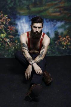 chris john millington thick black beard and mustache beards bearded man men mens' style hairstyle hair tattoos tattooed boots suspenders shirtless