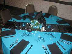 The Carolina Panther Table...My daughter recently married, she and her fiancé are super sports fans.. we created a different table for each of their favorite teams and how they met through Football. We had a Tailgating rehearsal dinner party....