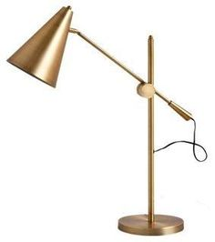 Give your space a modern elegance with this gleaming gold table lamp featuring sleek lines and a satin finish.