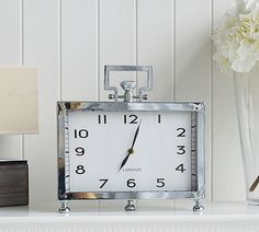 Silver mantel clock with handle. Living room home accessories from The White Lighthouse