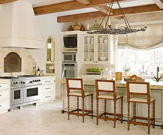 Architectural Impressions-Rustic stone tile and hand-scraped wood beams add the charm of an old French eatery to this new kitchen. Curved archways, intricate molding details, and patinaed finishes also enhance the look. French Country Dining Chairs, French Country Bedrooms, French Country Living Room, French Country Style, Top Country, Kitchen Ikea, New Kitchen, French Kitchen, Kitchen Mat