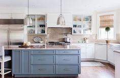 While all-white kitchen cabinetry is a classic look, we've been leaning towards color in the kitchen lately. What do you think of the trend? #kathykuohome #interiordesign #kitchen #inspiration  Design by @leblancdesign