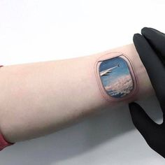 Airplane window tattoo on the left inner wrist. it's a bit weird but kinda cool.
