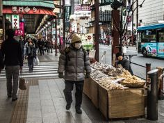 Street stalls in Asakusa are rare except during festivals/fairs. But you can often find this guy selling dried fruit on Kaminarimon Dori/Street or around the Rox -his mangoes are just great! Taken on January 21, 2014. © Grigoris A. Miliaresis