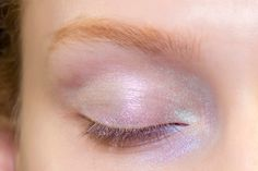 Gotten comfortable with some shimmer and want to embrace your truly disco self? Try a shadow with a pearlescent sheen all over your eyelid, as seen on Leonard runway. Bobbi Brown's Silver Lilac ($33) shadow has a great pearlized shimmer, so you can apply the shadow softly all over your lid. Or, if you want to go all-in, apply a cream shadow base and tap MAC's Transparent Pink Glitter ($22) lightly to the lid. Just remember, glitter is hard to remove so you'll be finding it everywhere for…