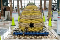 Canstruction NYC celebrates 20 years with over 100,000 cans converted into imaginative sculptures by 24 architecture, engineering and design firms.