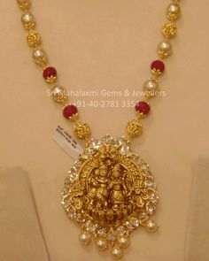 Temple Jewelry Long Necklace with Pearls & Ruby Beads with Uncut DiamondChain DetailsGross Weight GmsNet Weight GmsRuby Weight 34 CaratPearls Weight CaratPendent DetailsGross Weight GmsNet Weight GmsUncut Diamond Weight CaratPearls Weight Cara Gold Jewellery Design, Bead Jewellery, Temple Jewellery, Pendant Jewelry, Beaded Jewelry, Gold Jewelry, Gold Bangles, Pearl Jewelry, Jewelry Sets