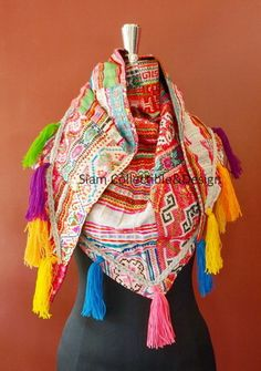 Hmmm..something like this without the tassels and a more subtle Hmong design.  If someone makes it, I'd buy it!
