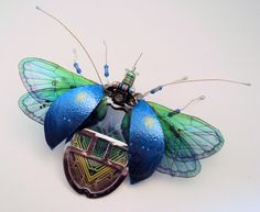 Hand sculptured bugs and beetles by artist Julie Alice Chappell. Insects made from recycled discarded electronics. Environmentally conscious art.
