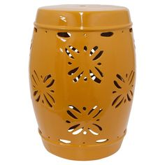 Offer guests an extra seat or rest a tray of cocktails atop this lovely ceramic garden stool, showcasing a cutout design and orange finish.