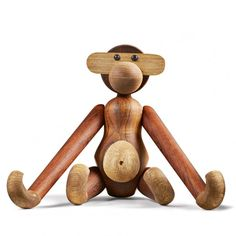Kay Bojesen Monkey By Rosendahl in Teak from Hus & Hem. Give a gift that will last a lifetime. Kay Bojesen's teak Monkey was born in 1951. A little pot-bellied Monkey with a great personality and impish expression that was produced in accordance with Bojesen's motto - that lines should smile. Full of soul, humour, and with a twinkle in his eye, he has become a classic and a dear friend for life – from being a popular toy in the playroom to a much-loved design icon in a future home.