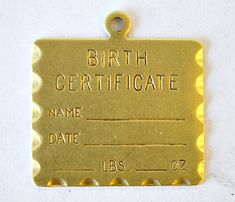 Birth certificate steel stamp, stamped jewelry.  https://www.etsy.com/listing/109485785/birth-certificate-stamping-blank-20mm-x