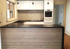 Natural Chalet Oak Laminate used to give this kitchen space a modern look.
