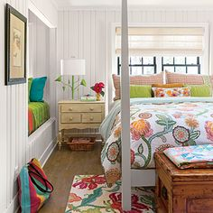 A light-filled guest room with colorful accents has a sleeping nook built into the wall, giving the space an extra spot for guests or a place  relax with a book.   Via Coastal Living