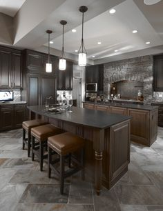 dark kitchen in grey & browns - more manly than anything with stone & leather mixed in. maybe with more simple/plain cabinets ?