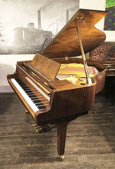 A 1990, Petrof baby grand piano with a walnut case and polyester finish at Besbrode Pianos £6000