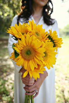 Simple, hand-tied bouquet of sunflowers. For the bride we could incorporate sprigs of lavender