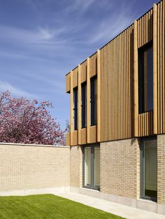 Thistle Foundation, Centre of Health & Wellbeing, Edinburgh, by Timber cladding, brick and pre-cast concrete to exterior. Photography courtesy of Cadzow Pelosi. Wood Facade, Brick And Wood, Brick Architecture, Timber Cladding, House Elevation, Modern Exterior, Building Materials, Townhouse, Wood Slats