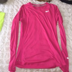 Nike long sleeve miler Long sleeve hot pink running miler. Barely worn! Great for layering or for running on a cool day! Flattering fit, make an offer! Nike Tops