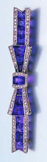 An early 20th century amethyst and diamond bow brooch, circa 1915 The tied ribbon bow set with a central row of calibré-cut amethysts, within a millegrain border of rose-cut diamonds, length 7.0cm. fitted case by Goldsmiths and Silversmiths Co. 112 Regent Street, London, W