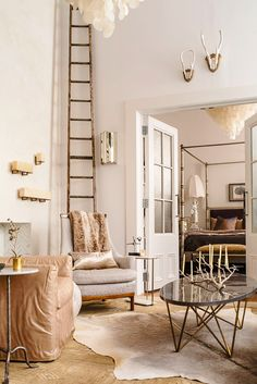 Tall, wood ladder in living room with antique furniture and elegant details