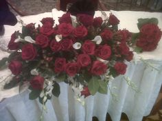 sweetheart table red roses white callas and white dendrobian orchids I know I take the worst pictures and I forgot to take pictures of the bouquets!!!