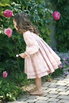 Resembles my daughter... at this age... going for walks to smell the roses in California...