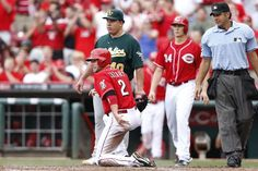 Zack Cozart #2 of the Cincinnati Reds kneels after sliding home with a run after a double by Corky Miller in the third inning of the game against the Oakland Athletics at Great American Ball Park on August 7, 2013 in Cincinnati, Ohio. (Photo by Joe Robbins/Getty Images)