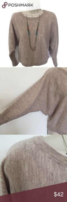 "Cynthia Rowley 100% Marino Wool Dolman Sleeve Swtr Beautiful sweater.  Can be dressed up for a professional look as well as dresses down with your favorite pair of comfy jeans.  Tag Size S.  Measurements; waist 31"", chest about 40"", ( hard to be exact due to sleeve design), length 22"".  ❣️No trades ❣️ Thanks for stopping by 🤗. Cynthia Rowley Sweaters"